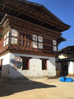Chimi Lhakhang traditional home telling you you're in the right direction