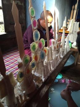 A monk making ritual cakes at a farmer's home